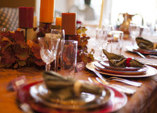 Thanksgiving Table. A table set for Thanksgiving dinner with fall colors Stock Images