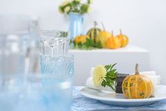 Thanksgiving table setting. With decorative pumpkins Stock Photo