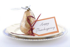 Thanksgiving table setting with gold pear. Royalty Free Stock Image