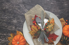 Thanksgiving Table Setting. Thanksgiving holiday table setting arrangement Stock Photography