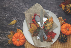 Thanksgiving Table Setting. Thanksgiving holiday table setting arrangement Stock Image