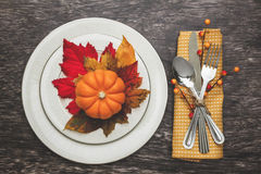 Thanksgiving Table Setting. Thanksgiving holiday table setting arrangement Stock Photo