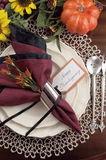 Thanksgiving table setting with lace doily place setting  - vertical. Beautiful Thanksgiving table setting with lace doily place setting and fine bone chia with Royalty Free Stock Image