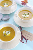 Thanksgiving table setting with pumpkin soup. Stock Photo