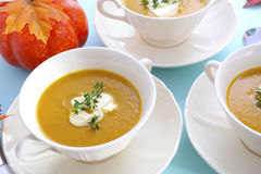 Thanksgiving table setting with pumpkin soup. Royalty Free Stock Photography