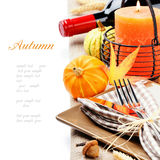 Thanksgiving table setting with pumpkins. And candle isolated on white Stock Image