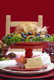 Thanksgiving Table Setting with Roast Turkey on Red White Backgr Stock Photo