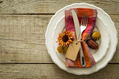 Thanksgiving table setting on rustic wood background. Autumn table setting on rustic wood background, copy space Royalty Free Stock Image