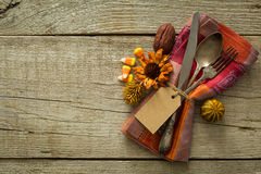 Thanksgiving table setting on rustic wood background. Copy space Stock Photos