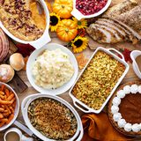 Thanksgiving table with turkey and sides. Thanksgiving table with roasted turkey, sliced ham and side dishes stock images