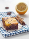 Thanksgiving treat. Marble chocolate brownies with pumpkin. Freshly baked homemade brownie. Selective focus on the front. Vertical Royalty Free Stock Image