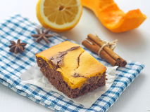 Thanksgiving treat. Marble chocolate brownies with pumpkin. Piece of freshly baked brownie. Thanksgiving treat. Marble chocolate brownies with pumpkin Stock Photography