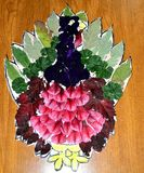 Kids crafts turkey with leaves and flower petals stock images