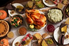 Thanksgiving Turkey Dinner with All the Sides. Homemade Roasted Turkey and all traditional dishes on Festive Thanksgiving table with autumnal decor stock images