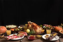 Thanksgiving Turkey Dinner with All the Sides. Homemade Roasted Turkey and all traditional dishes on Festive Thanksgiving table, copy space stock image