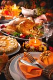 Thanksgiving turkey dinner. Thanksgiving dinner. Roasted turkey garnished with cranberries on a rustic style table decoraded with pumpkins, vegetables, pie stock photos