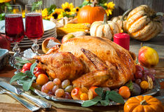 Thanksgiving turkey. Thanksgiving dinner. Roasted turkey on holiday table with pumpkins, flowers and wine