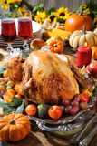 Thanksgiving turkey. Thanksgiving dinner. Roasted turkey on holiday table with pumpkins, flowers and wine royalty free stock images