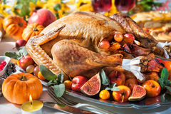 Thanksgiving turkey. Thanksgiving dinner. Roasted turkey on holiday table with pumpkins, flowers and wine royalty free stock photography