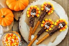 Thanksgiving turkey pretzel rods, overhead on wood. Funny Thanksgiving turkey pretzel rods with candy corn, overhead scene on old wood Royalty Free Stock Photography