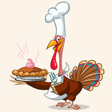 Thanksgiving turkey serving hot pumpkin pie Royalty Free Stock Images
