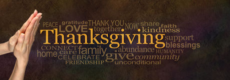 Thanksgiving Word Cloud Website Banner. Female hands in prayer position alongside a golden 'Thanksgiving' word surrounded by a relevant word cloud on a warm dark