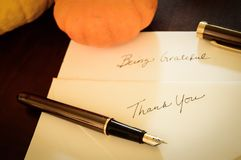 Thanksgiving writing thank you background. Vintage Thanksgiving thank you card with fountain pen and hand written note royalty free stock photos