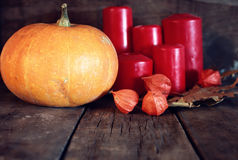 Thanksgivings day pumpkin and candles Royalty Free Stock Photography