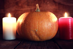 Thanksgivings day pumpkin and candles Stock Photos