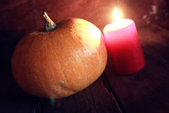 Thanksgivings day pumpkin and candles Royalty Free Stock Images