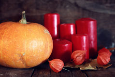 Thanksgivings day pumpkin and candles Stock Image