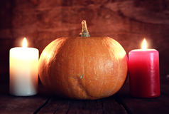 Thanksgivings day pumpkin and candles Royalty Free Stock Image