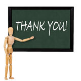 Thankyou. Mannequin pointing to blackboard with the text thankyou royalty free stock images
