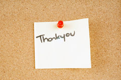 Thankyou note pinned to a corkboard Stock Photos