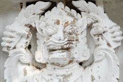Thao Wes Suwan low relief statue on wall Royalty Free Stock Image