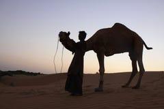 THAR DESERT CAMEL DRIVER royalty free stock image