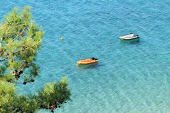 Thasos island , Greece. Two small boats, on crystal clear water , in Thasos island - Greece Stock Image