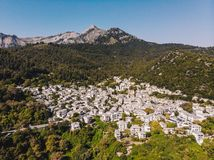 Thasos island small town of Panagia in the middle of the island, with houses painted in white and stone roofs, traditional greek. Way. Thasos or Thassos Island royalty free stock photo