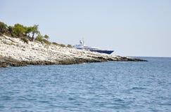 Thassos, August 21st: Rocks Cliff on the Aegean Sea near Thassos island in Greece stock photo
