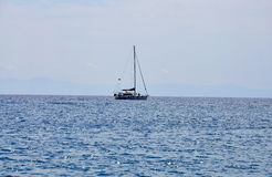 Thassos, August 21st: Sailing Boat on the Aegean Sea near Thassos island in Greece. Sailing Boat on the Aegean Sea near Thassos island in Greece on August 21st Royalty Free Stock Photo