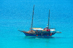 THASSOS, GREECE - SEPTEMBER 05 2016 - Tourists on old sailing ship in Thassos, Greece Stock Image