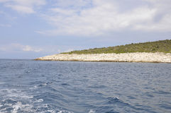 Thassos island Cliff viewed from Cruise around on the Aegean Sea in Greece. On a beautiful day of summer stock images