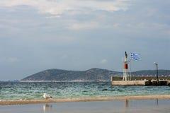 Thassos island, Greek flag in port Royalty Free Stock Photo