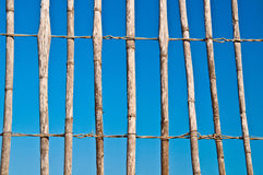 Thatch fence. Loosely fitted thatch fence with bright and clear blue sky in the background Stock Photos
