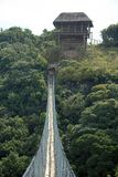 THATCH LOOKOUT ON FAR SIDE OF SUSPENSION BRIDGE OVER ORIBI GORGE. View of suspended bridge and lookout point over part of Oribi Gorge canyon in Kwazulu Natal Stock Photography