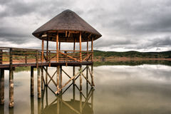 Thatch pavilion on lake in Karoo Royalty Free Stock Image