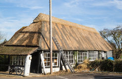 Thatch roof being renewed Stock Photos