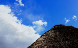 Thatch roof and blue sky Royalty Free Stock Photography