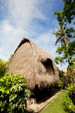 Thatch roof bungalow at tropical resort Stock Photo