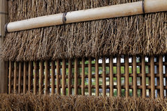 Thatched and bamboo fences wall Stock Photos
